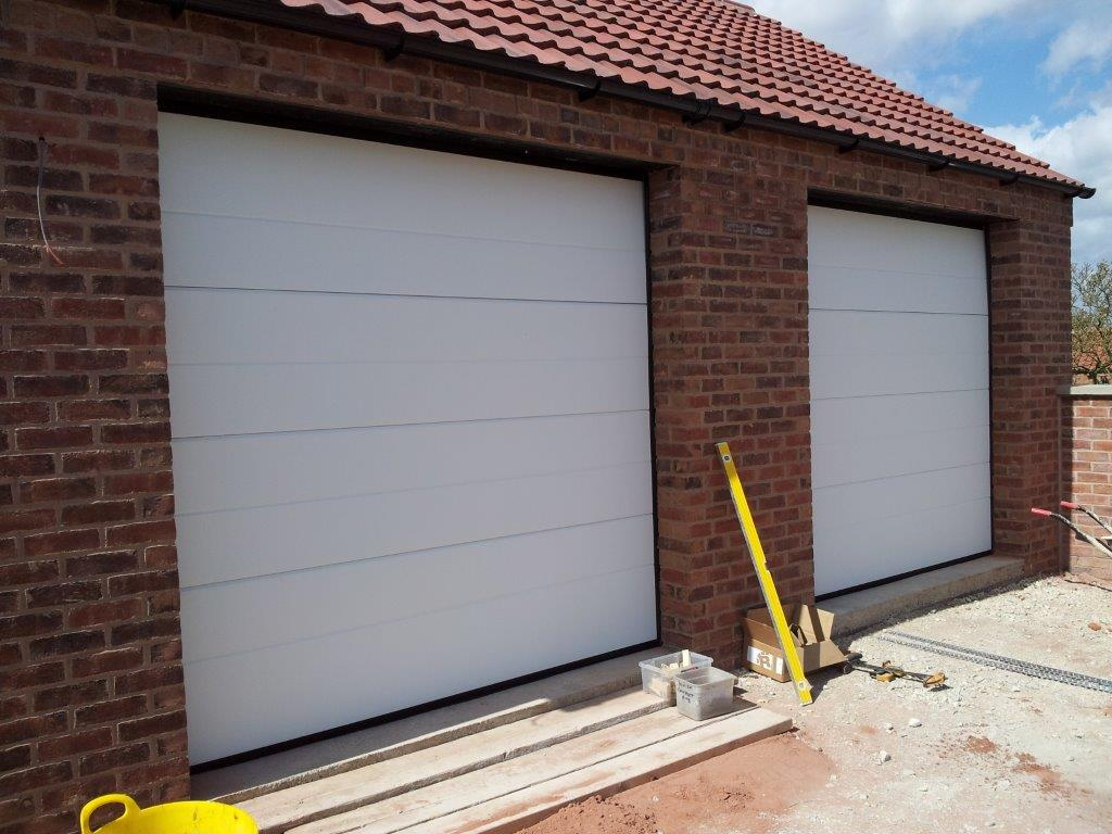 Midrib garage doors 16 garage doors north wales for 16 x 21 garage door panels
